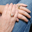 Diamond rings on married seniors hands - Stock Photo