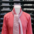 Red shirt in the store with a pink tie — Stock Photo #15975957
