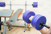 Dumbbell and gym — Stock Photo