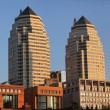 Stok fotoğraf: Two tall buildings at sunset