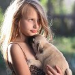 Happy child holding a small dog — Stock Photo