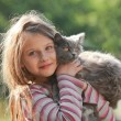 Happy child with cat. Kid showing — Stock Photo