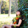 Female sitting under a tree — Foto de Stock