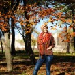 Girl in autumn leaves. — Stock Photo #13901570