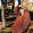 Girl in autumn park. - Stockfoto