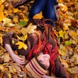 Stock Photo: Girl lying in leaves.