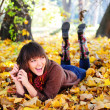 Girl lying in leaves. — Stock Photo #13901612