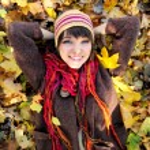 Girl lying in leaves. — Stock Photo #13901619