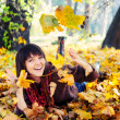 Girl lying in leaves. — Stock Photo #13901640