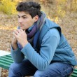 Young man sitting in park. — Stockfoto