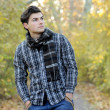 Young man portrait in park. - Stockfoto