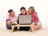 Friends with laptop. — Stock Photo