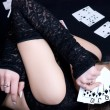Woman holding playing cards — Foto Stock