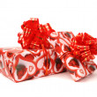 Gift boxes with red bow. — Stock Photo