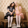 Girls dressed as dolls. - Stockfoto