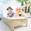 Womin hat lie on lounger. — Stock Photo #14200963