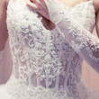 Stock Photo: Brides dress corset.