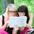 Student girls reading the book — Stock Photo