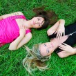 Girls laying in grass — Stock Photo #14202514
