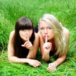 Girlfriends talking secret — Stock Photo