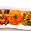 Different vegetable salads on plate. — Stock Photo