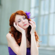 Young woman portrait with flower in her hair. — Stock Photo