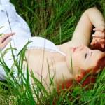 Female sleeping on grass — Stock Photo #14203263