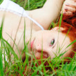 Stock Photo: Female lying on grass field