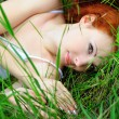 Female lying on grass field — Stock Photo #14203294