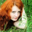 Female lying on grass field — Stock Photo #14203309