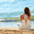 Young girl in a white dress on beach - Stock Photo