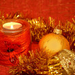 Christmas composition with a candle - Stock Photo