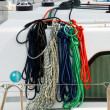 Coloured rope on a board of new yacht - Stock Photo