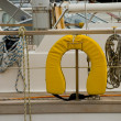 Life jacket and cord on board a yacht in harbour - Stock Photo
