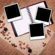 Open notebook with polaroid — Stockfoto