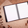 Royalty-Free Stock Photo: Open notebook on sacking