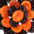 Dried apricots and prunes - Stock Photo