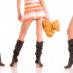 Beautiful girls legs and bears. — Stock Photo