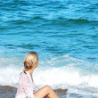 Blond girl on a sea beach — Stock Photo