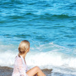 Blond girl on a sea beach - Stockfoto
