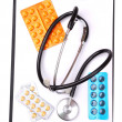 Medical clipboard, stethoscope and pills — Stock Photo