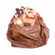 Stock Photo: Ladies' handbag with cosmetics and toy a bear