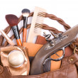 Handbag with cosmetics and pistol - Stock Photo