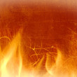 Close-up of fire on a background of an old wall — Stock Photo