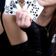 Sexy woman holding playing cards — Stock Photo
