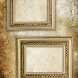 Wall with antique frames - Stock Photo