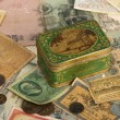 Background with old currency and box — Stock Photo
