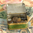 Old currency and box with old coins — Stock Photo