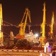 Seaport with cranes at night — Stockfoto