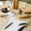 Utensils, notebook and glass of wine — Stock Photo #14209617